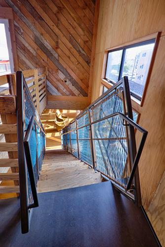 Celery - the stair from above with woven cord panels.