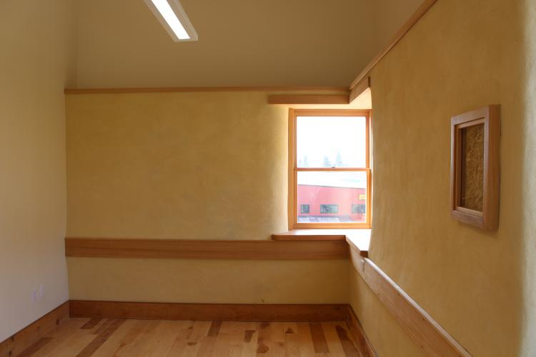 Mahonia plastered straw bale wall